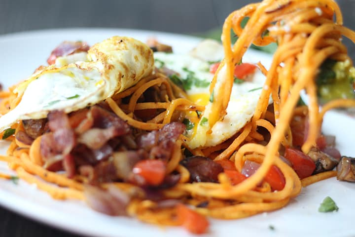 Fried Egg and Sweet Potato Noodles with Bacon & Vegetable Hash
