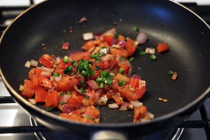cooking huevos rancheros sauce