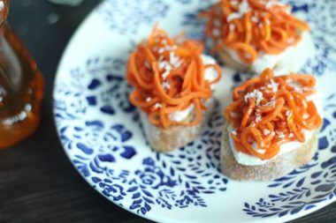 Maple-Honey Roasted Carrot Noodle Ricotta Crostini with Coconut Flakes