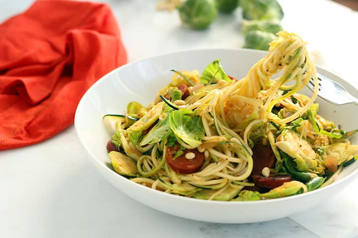 Shaved Brussel Sprout and Chorizo Zucchini Pasta with Toasted Pine Nuts