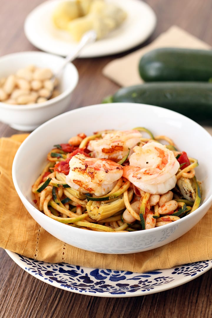 Tomato Zucchini Noodles with Shrimp, Roasted Artichokes and Cannellini Beans