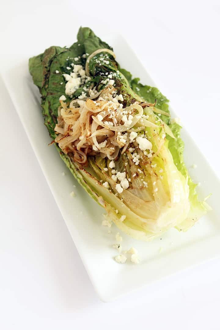Grilled Romaine with Caramelized Onion Noodles, Blue Cheese and Greek Yogurt Balsamic Dressing