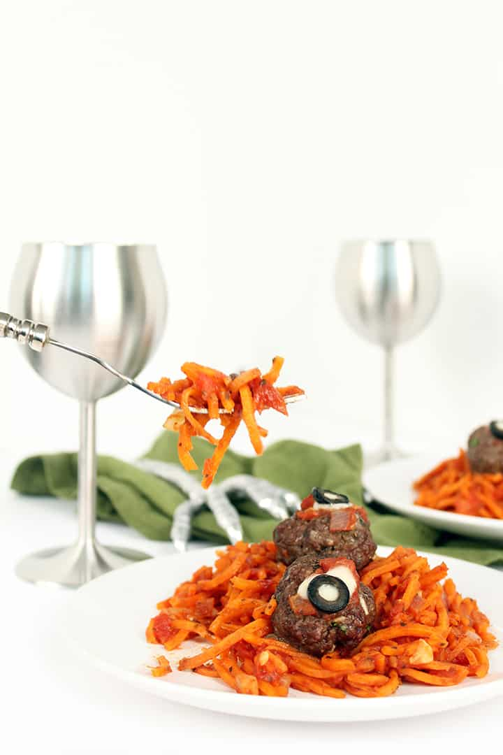 "Spooky Sweet Potato ""Worms"" with Oozing Beef ""Eyeballs"""