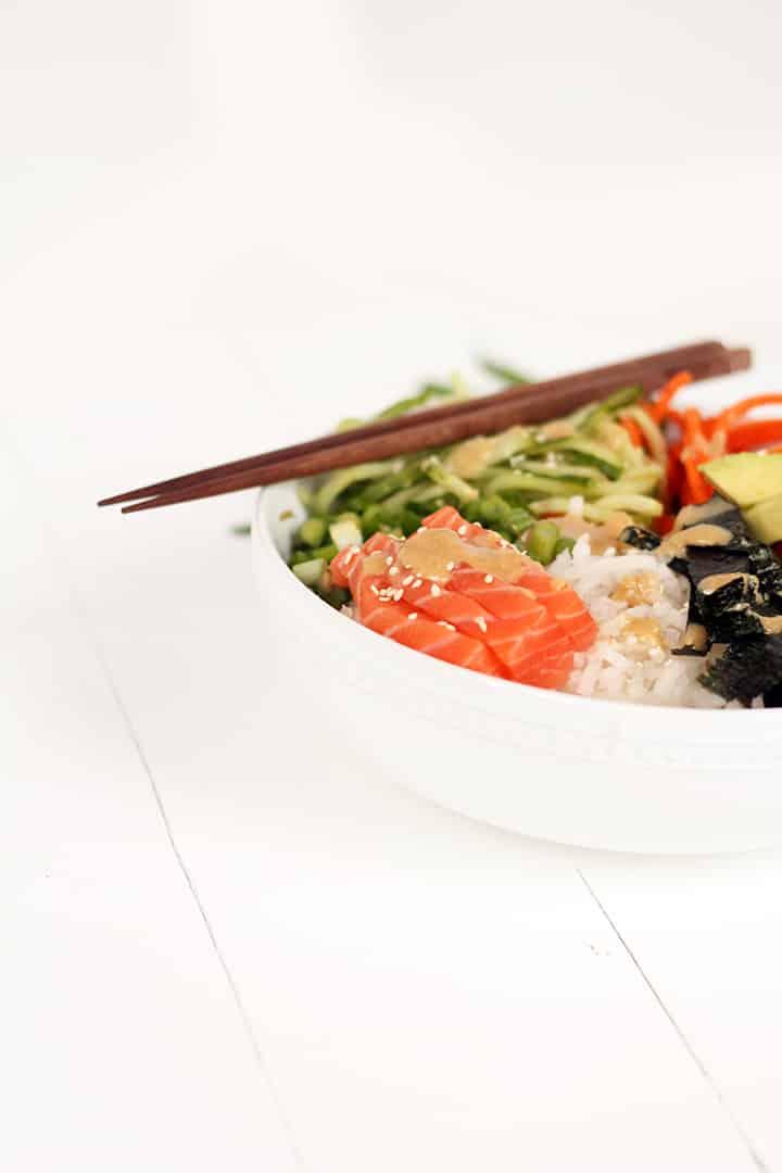 Spiralized Sushi Bowl with Salmon Sashimi and Ginger Miso Dressing