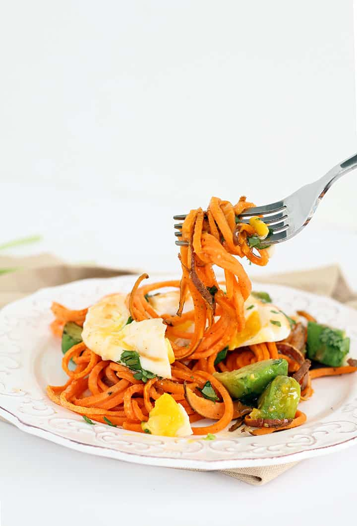 """Spiralized Paleo Eggs """"Benedict"""" with Roasted Sweet Potato Noodles, Avocado and Chipotle Hollandaise"""