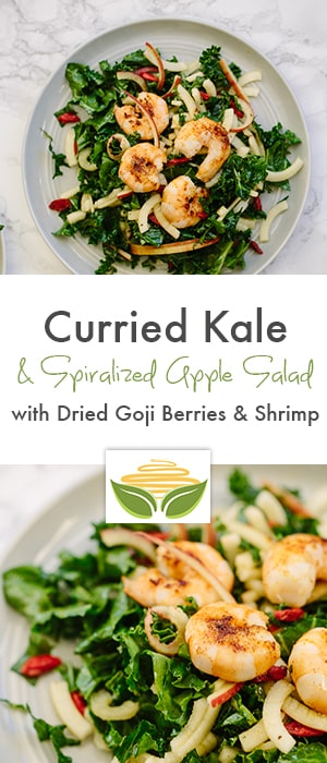 curried kale and spiralized apple salad with dried goji berries and shrimp