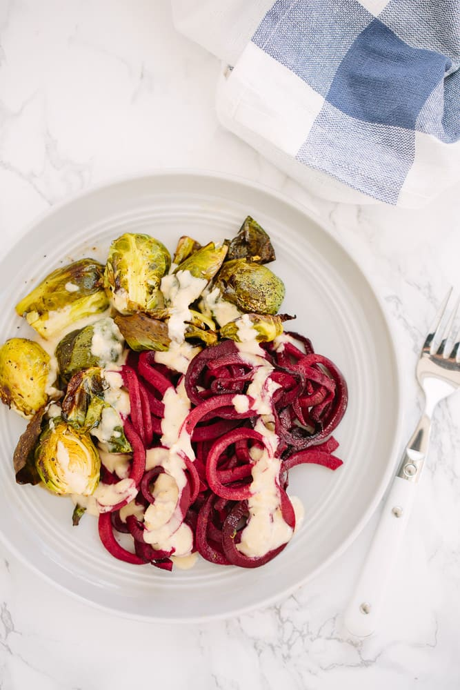 Balsamic Roasted Spiralized Beets with Brussels Sprouts and Hummus Dressing