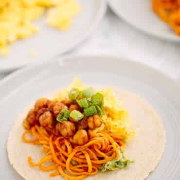 BBQ Chickpea Sweet Potato Noodle Breakfast Tacos with Eggs, Avocado Sauce and Scallions