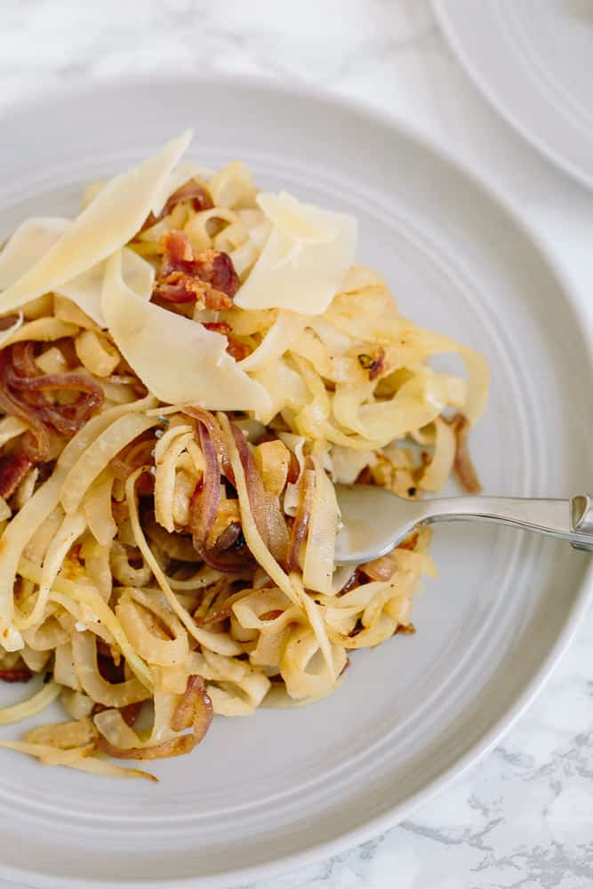 Caramelized Onion and Bacon Kohlrabi Spaghetti with Shaved Parmesan