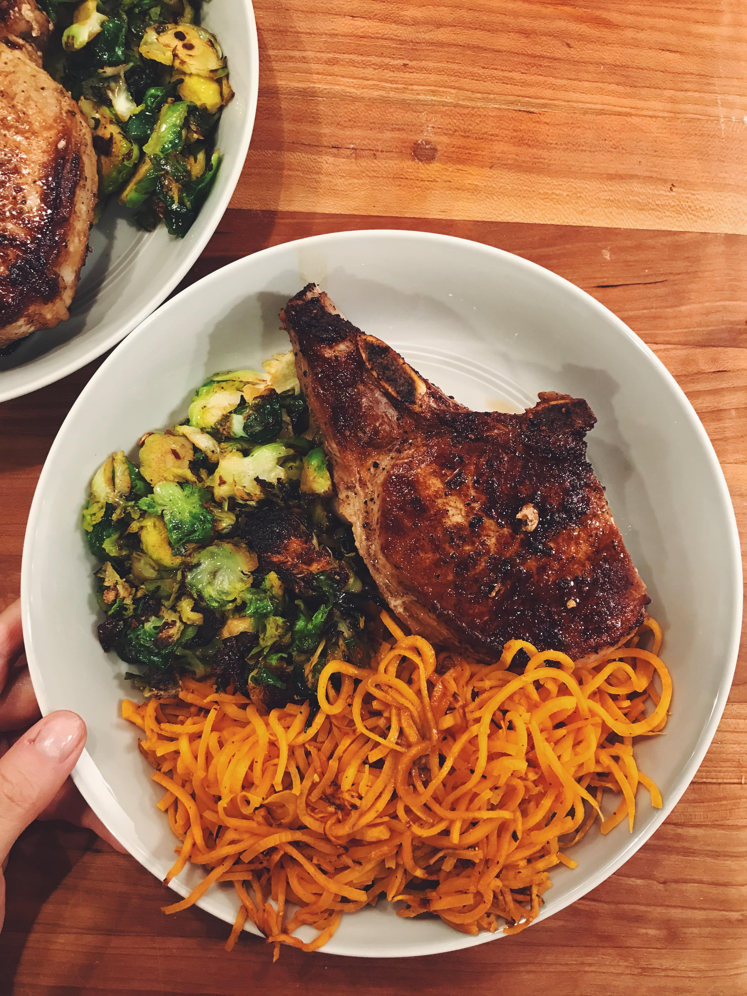 Crispy Pork Chops with Spiralized Sweet Potatoes and Charred Brussels Sprouts
