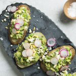 Potato Toasts with Green-Pea Avocado Mash and Shaved Egg