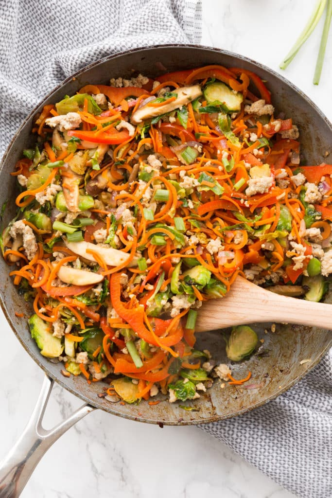 Inspiralized Spicy Stir Fried Chicken And Shredded Brussels Bowls